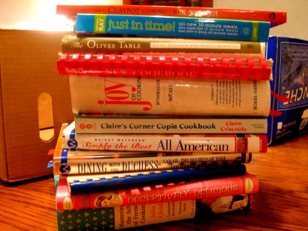Stack of Cookbooks via A Better Bag of Groceries.