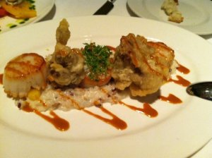 Seared Day Boat Scallops with BN Squash Risotto & Lobster Fondue drizzle.