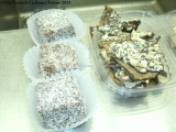 Freshly made Lamingtons and Almond Roca prepped for sale.