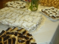 Close Up of Chocolate Eclairs, Victoria Sponge Cake with Berries and Cream, Scones with Raspberry Jam & Clotted Cream.